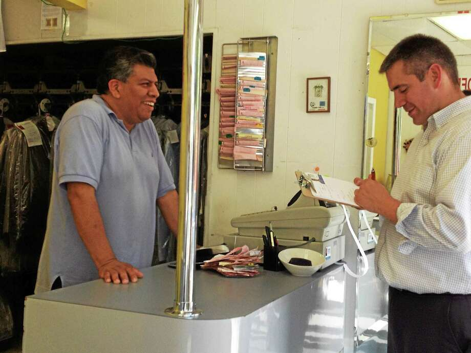 West Haven mayoral hopeful Nick Pascale, right, speaks with Cameo Cleaners owner Edgar Ojeda Wednesday as part of a walking tour of businesses on Campbell Avenue. Photo: MARK ZARETSKY — NEW HAVEN REGISTER
