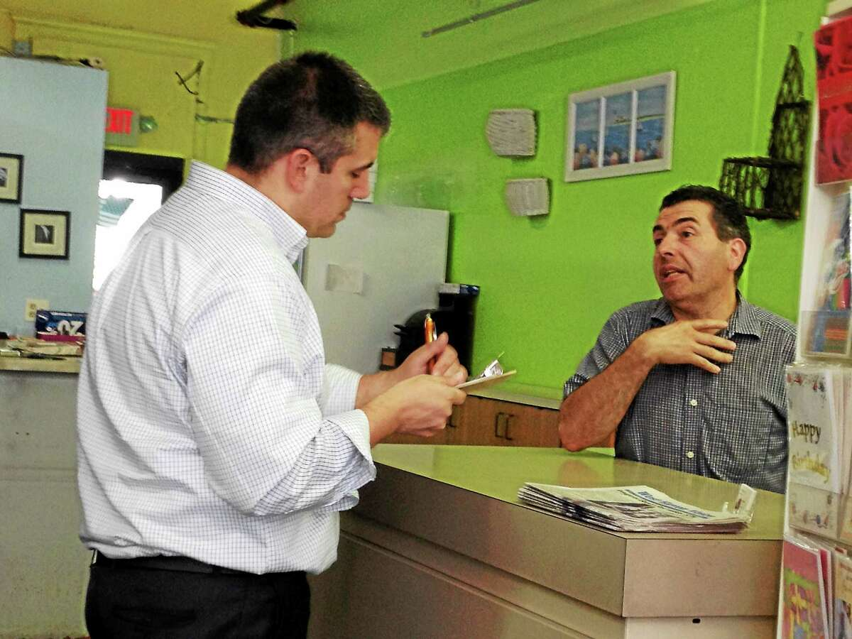 Pascale speaks with The Flower Affair employee Pete Macchiarelli.