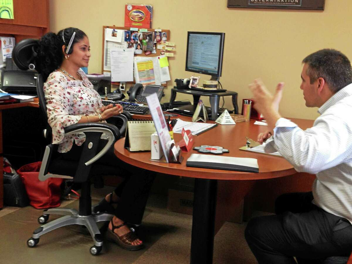 Pascale talks to State Farm insurance office owner Elsie Encarnacio Wednesday.