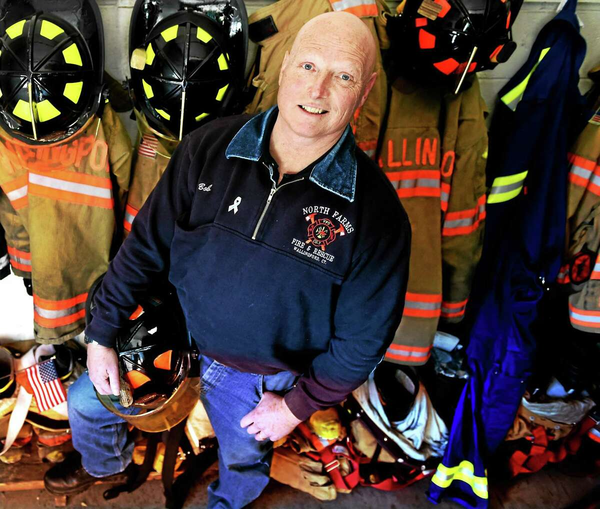 North Farms Volunteer Fire Department of Wallingford firefighter and EMT Robert Huebner at the fire station Monday. Huebner is a male breast cancer survivor. This week is Male Breast Cancer Awareness Week.