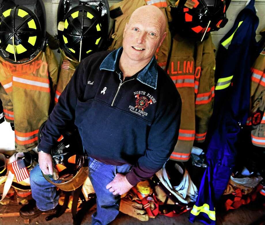 North Farms Volunteer Fire Department of Wallingford firefighter and EMT Robert Huebner at the fire station Monday. Huebner is a male breast cancer survivor. This week is Male Breast Cancer Awareness Week. Photo: Peter Hvizdak — New Haven Register   / ©2015 Peter Hvizdak