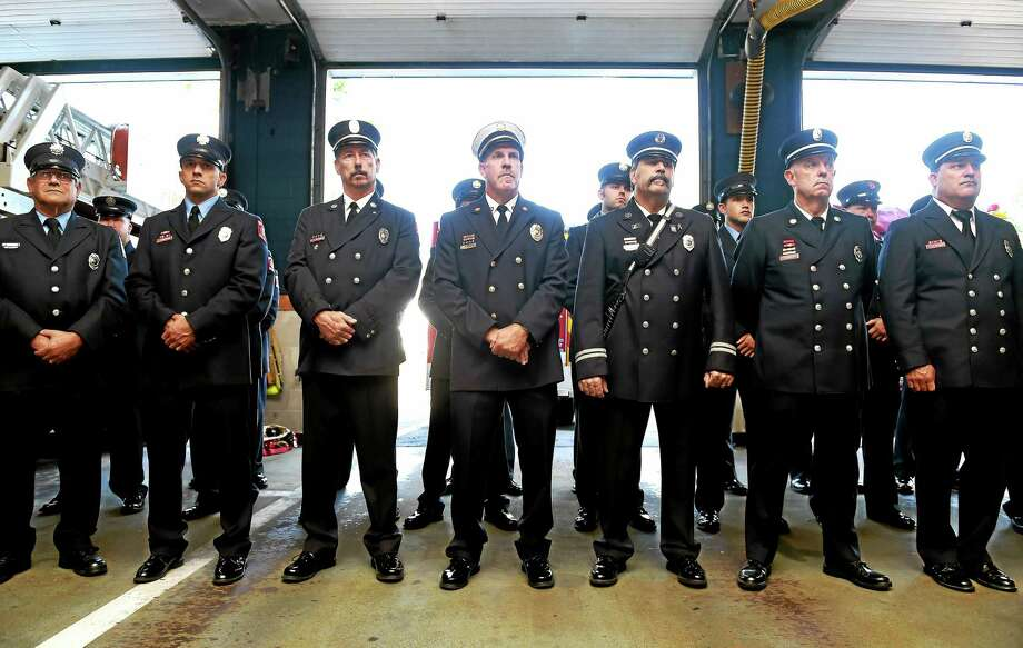 Members of the West Haven Fire Department who responded to the September 11 attacks on the World Trade Center in New York City listen to U.S. Sen. Richard Blumenthal speak about the need for a permanent extension of the World Trade Center Health Program and September 11th Victim Compensation Fund as the James Zadroga 9/11 Health and Compensation Reauthorization Act during a press conference at the Center Fire Station in West Haven Friday. Photo: Arnold Gold — New Haven Register