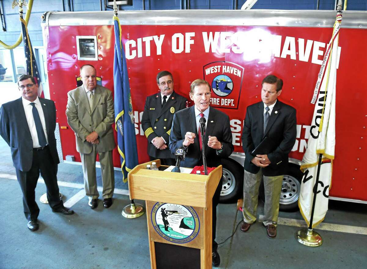 U.S. Sen. Richard Blumenthal, center, speaks about the need for a permanent extension of the World Trade Center Health Program and September 11th Victim Compensation Fund Friday in West Haven. Also shown are, from left, West Haven Mayor Ed O'Brien, state Rep. Stephen Dargan, West Haven Fire Chief James O'Brien, and Chris Tracy, vice president at large, Uniformed Professional Fire Fighters Association of Connecticut.