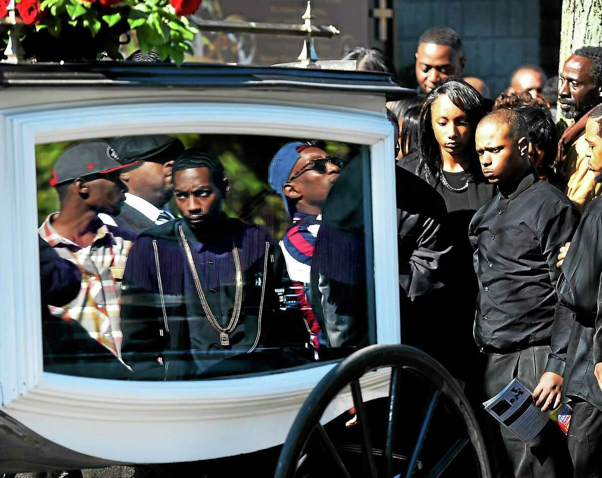 (Peter Hvizdak - New Haven Register) Mourners view the casket of Antoine Heath of West Haven in a horse drawn hearse after his funeral Monday, October 19, 2015 at the Varick Memorial African Methodist Episcopal Zion Church on Dixwell Avenue in New Haven. Heath was murdered last Thursday on Chapel Street in New Haven near Edgewood Park.