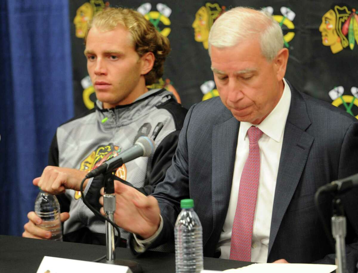The Chicago Blackhawks Patrick Kane, left, and John McDonough wait to answer questions Thursday during a media availability on the first day of training camp at the Compton Family Ice Center on the campus of the University of Notre Dame in South Bend, Ind.