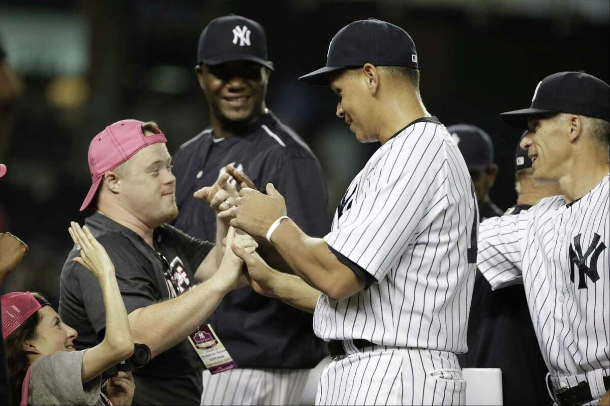 The Yankees' Alex Rodriguez, center, celebrates with Yankees' Hope Week honorees after a win over the Minnesota Twins on Tuesday in New York.