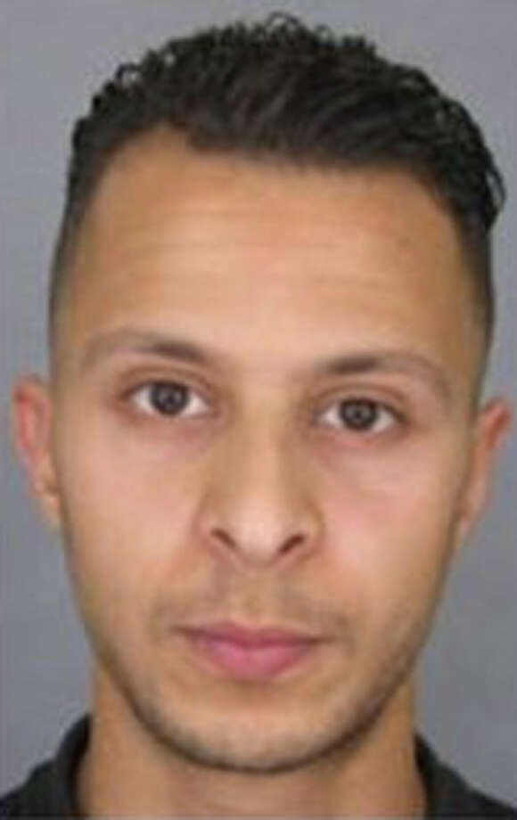 This undated file photo provided by French Police shows 26-year-old Salah Abdeslam, who is wanted by police in connection with recent terror attacks in Paris. French police released the wanted notice and photo of the suspect on the run since the attacks in Paris on Friday.  The notice, released on the France National Police Twitter account, says anyone seeing Salah Abdeslam, should consider him dangerous. Photo: Police Nationale Via AP   / Police Nationale