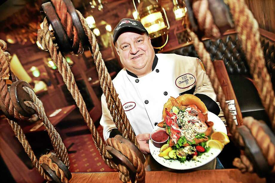 John Bencivengo, Jr., executive chef at the U.S.S. Chowder Pot III Restaurant reels in his famous Surf Salad with lobster, shrimp and lump crab meat, Thursday, November 12, 2015, in the dining room, at 560 East Main Street in Branford. Debbie and Johnathan Smith, owners of one of Connecticut's top seafood restaurants will celebrate their 35th anniversary from Monday, November 16 through Friday, November 20. Visit their website, www.chowderpot.com or call 203-481-2356. Photo: (Catherine Avalone - New Haven Register)       / New Haven RegisterThe Middletown Press
