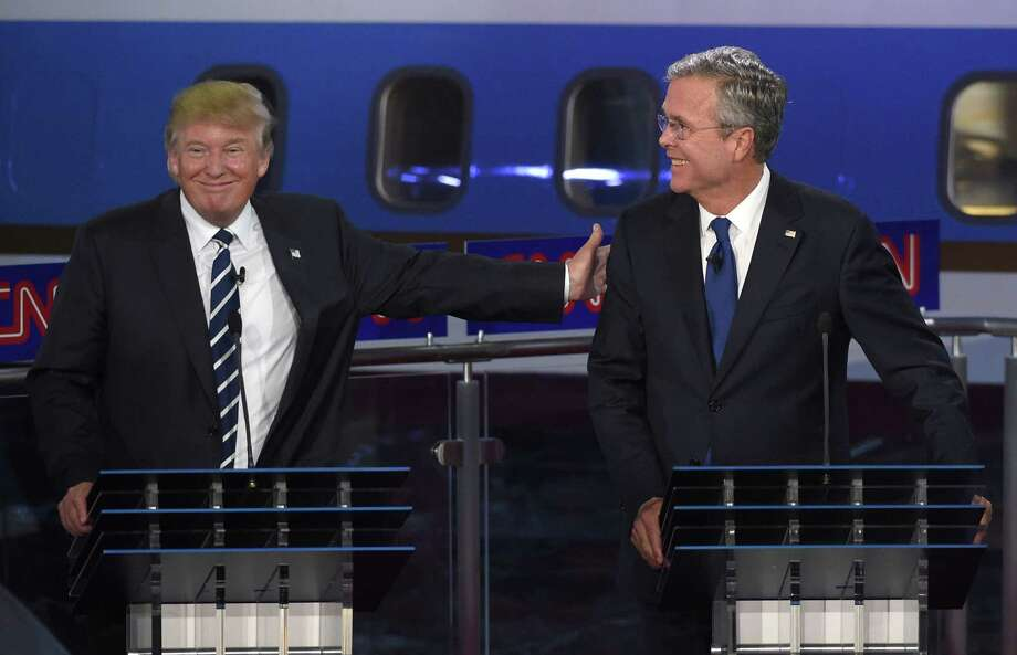 Republican presidential candidate, former Florida Gov. Jeb Bush, right, and Donald Trump joke during the CNN Republican presidential debate at the Ronald Reagan Presidential Library and Museum on Wednesday, Sept. 16, 2015, in Simi Valley, Calif. Photo: (AP Photo/Mark J. Terrill) / AP