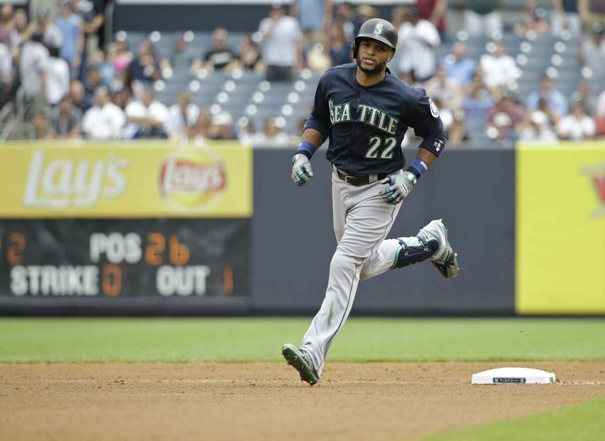 The Seattle Mariners' Robinson Cano rounds the bases after hitting a two-run home run in the first inning of Saturday's game against the Yankees on Saturday in New York.