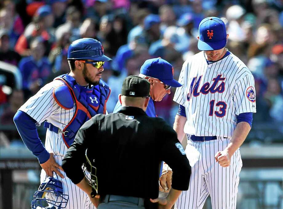 Relief pitcher Jerry Blevins (13) has re-signed with the Mets. Photo: Kathy Kmonicek — The Associated Press File Photo   / FR170189 AP
