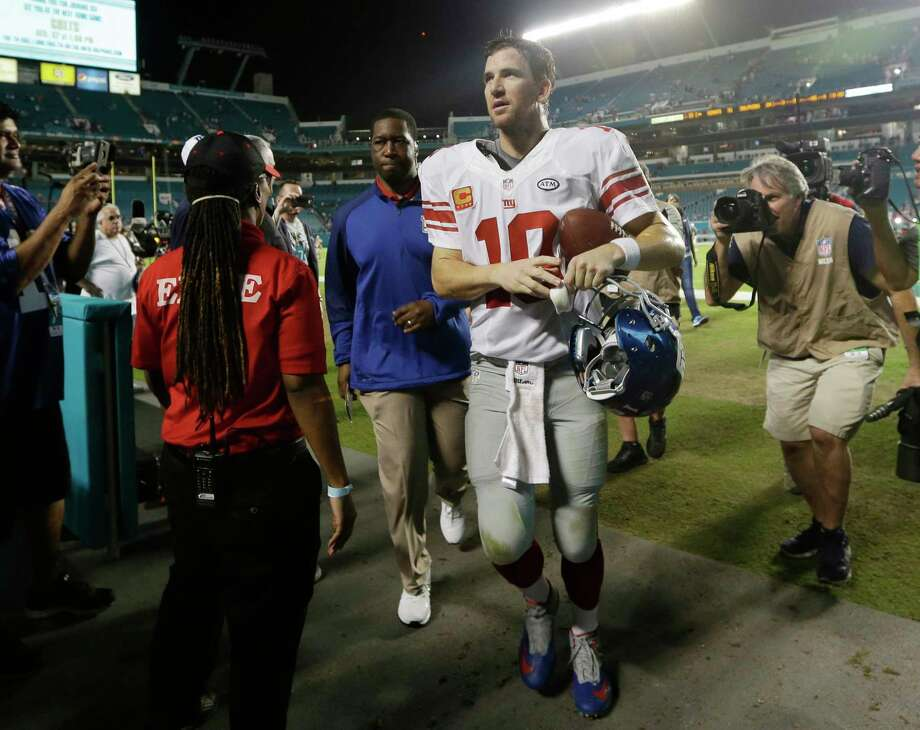 Giants quarterback Eli Manning leaves the field after a 31-24 win over the Dolphins in Miami. Photo: Lynne Sladky — The Associated Press   / AP