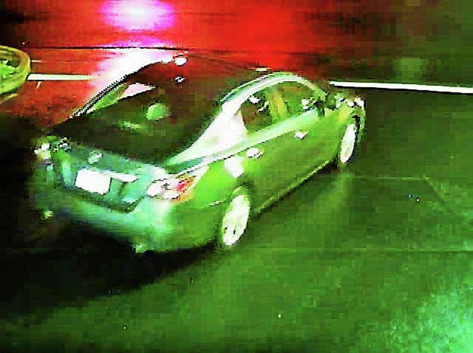 Guilford police released this surveillance image of a vehicle in which a suspect reportedly fled after he tried to hold up the Xtramart, 1675 Boston Post Road early Tuesday morning. Photo: Photo Courtesy Of The Guilford Police Department