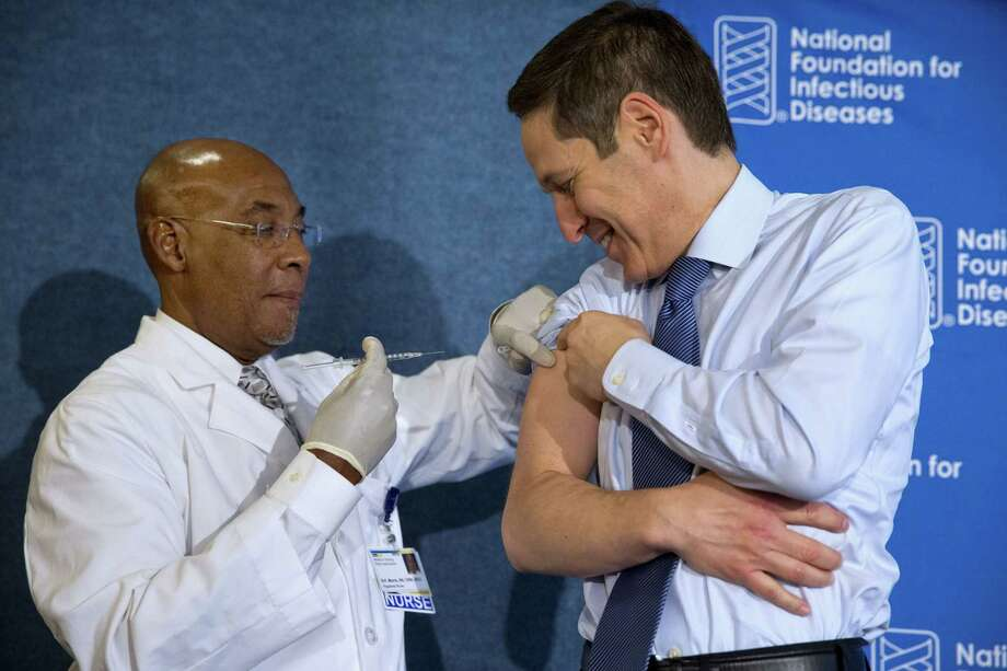 Nurse B.K. Morris, left, prepares to give the flu vaccine to Centers for Disease Control and Prevention Director Dr. Tom Frieden during an event about the flu vaccine on Sept. 17, 2015 at the National Press Club in Washington. It's time for flu shots again, and health officials expect to avoid a repeat of the misery last winter, when immunizations weren't a good match for a nasty surprise strain. Photo: AP Photo/Jacquelyn Martin   / AP