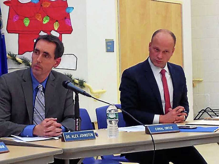 New Haven Superintendent of Schools Garth Harries, right, awaits the Board of Education vote on the extension of his contract. Board member Alex Johnston, left, was a co-chairman of the evaluation committee. Photo: Brian Zahn — New Haven Register