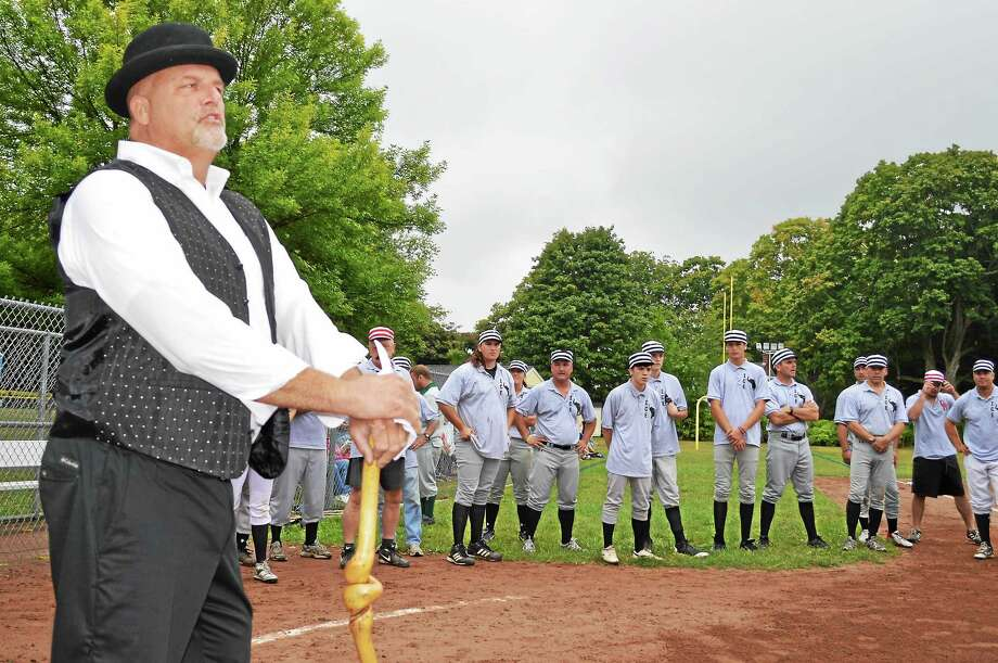"""CONTRIBUTED PHOTO  Doug Senn of Essex as """"adjudicator"""" (meaning umpire in 1850s) with some of the players. Photo: Journal Register Co."""