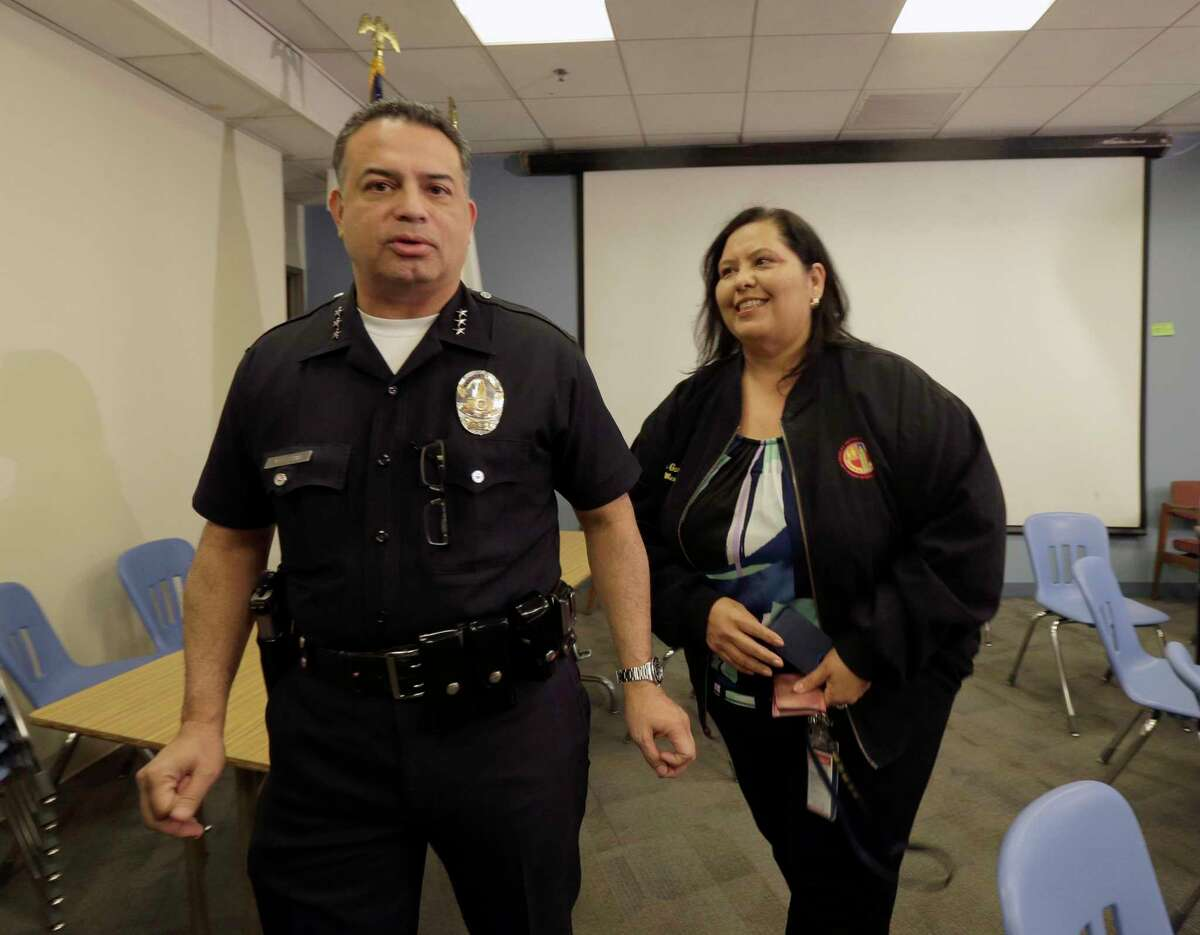 School board member Monica Garcia , right with Los Angeles school police Chief Steve Zipperman speaks to media after officials closed all Los Angeles Unified School District campuses due to an electronic threat, Tuesday, Dec. 15, 2015 in Los Angeles. Officials would not elaborate on the threat, saying it was still being evaluated, but said the shutdown came as a precaution.