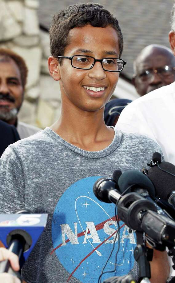In this Sept. 16, 2015 photo, Ahmed Mohamed, 14, thanks supporters during a news conference at his home in Irving, Texas. The arrest and three-day suspension of Mohamed, whose teacher mistook his homemade clock for a bomb, led to widespread ridicule of school officials and accusations that Islamophobia may have played a part. Ahmed's suspension reflects the rigid disciplinary policies that many U.S. schools adopted in the 1990s. Photo: AP Photo/Brandon Wade, File   / FR168019 AP