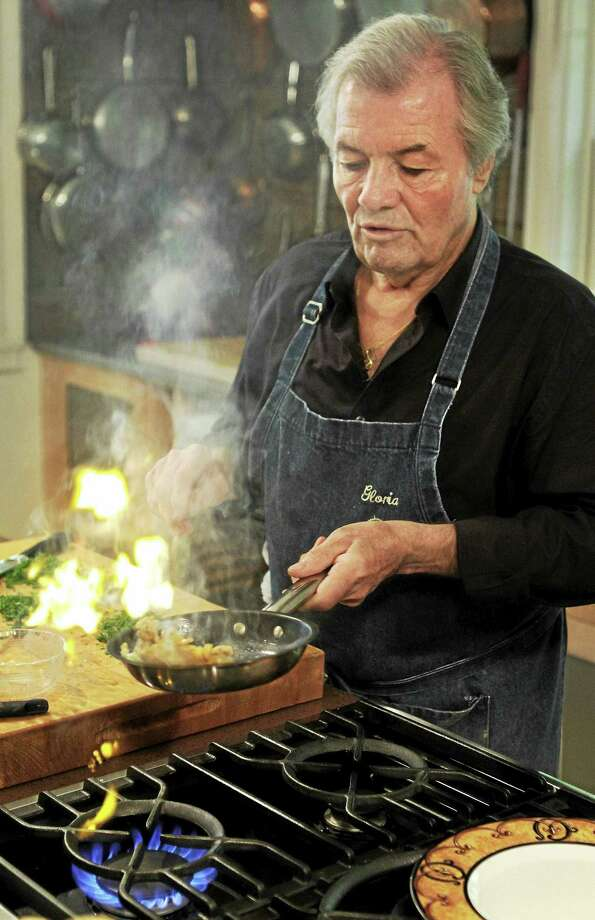 Chef Jacques Pepin demonstrates making an omelet at his home in Madison. Photo: Steven Senne — Associated Press File   / AP2011