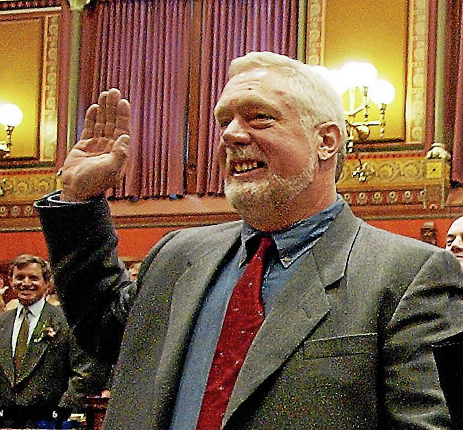 In this 2003 file photo, state Rep. Terry Backer, D-Stratford, takes the oath of office in the Hall of the House at the state Capitol in Hartford. Photo: Associated Press   / AP