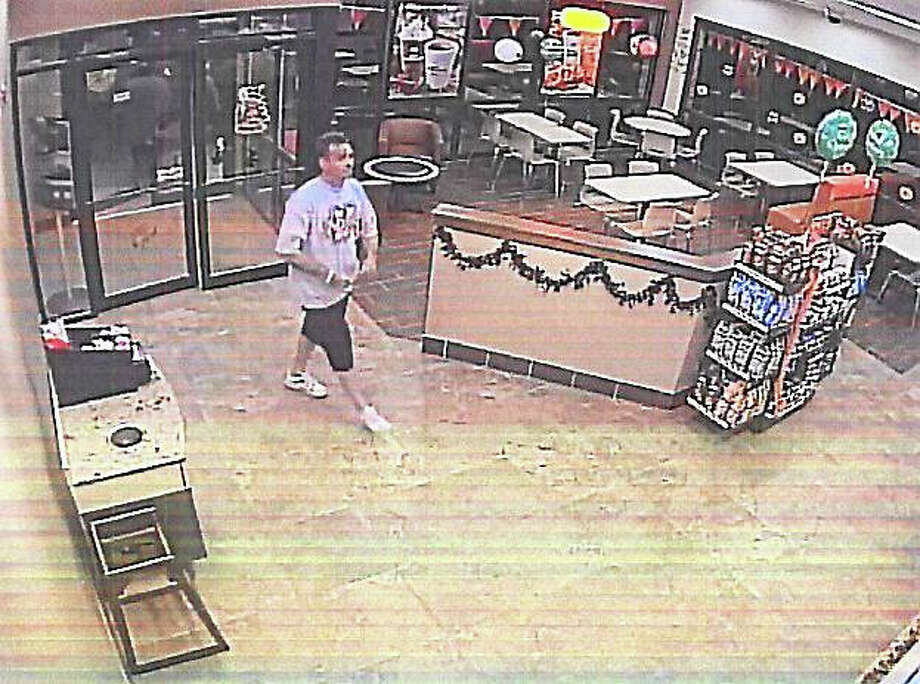 A still photo of surveillance footage captured at Dunkin' Donuts on East Frontage Road in East Haven. (Courtesy of East Haven police) Photo: Journal Register Co.