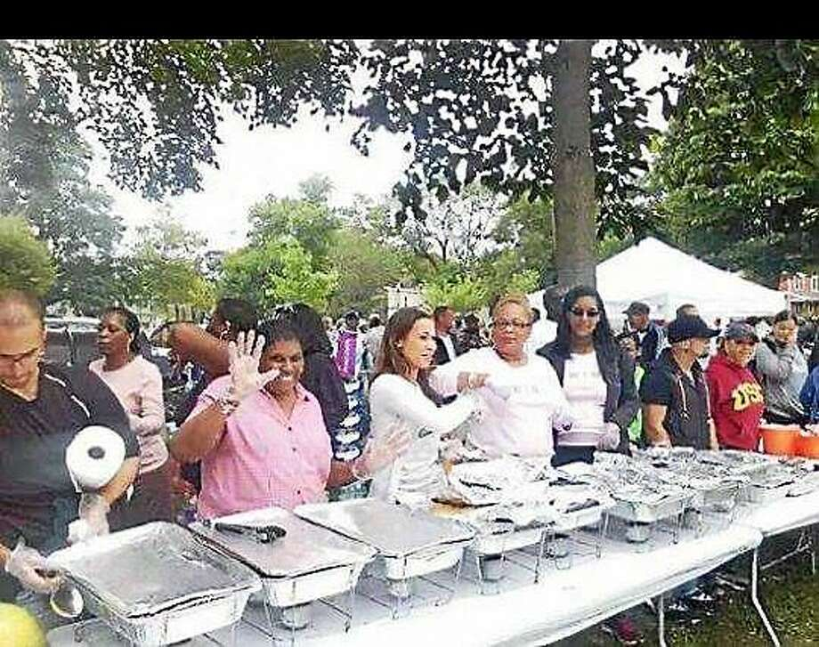 (Contributed photo) Volunteers put on quite a meal at last year's Extravagant Cookout for the Homeless in New Haven Photo: Journal Register Co.