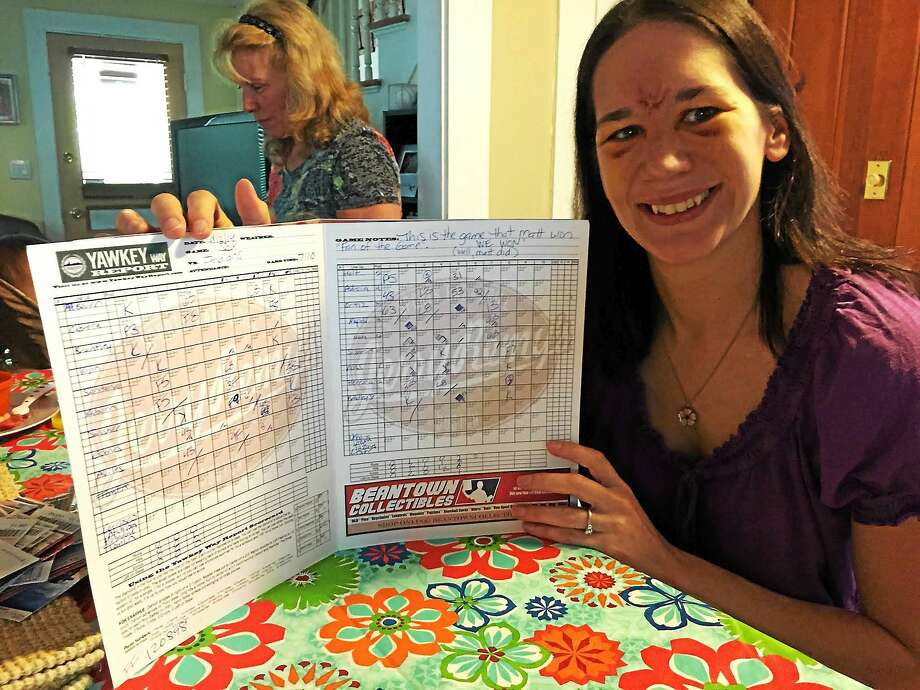 Stephanie Wapenski holds a scorecard from the day her fiance, Matt Fraenza, proposed to her at Fenway Park in Boston. Photo: Esteban L. Hernandez - New Haven Register