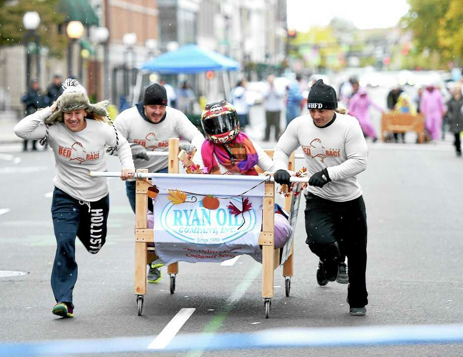 The Ryan Oil Company team competes in an early heat at the resurrected New Haven Bed Race on Church St. in New Haven on 10/18/2015.  They were the overall winners of the event. Photo: Arnold Gold -- New Haven Register