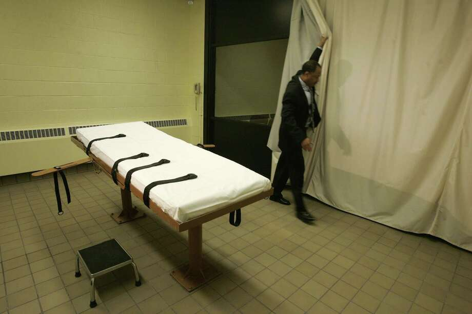 In this Nov. 2005, file photo, public information director Larry Greene is shown in the death chamber at the Southern Ohio Correctional Facility in Lucasville, Ohio. Photo: AP File Photo   / AP