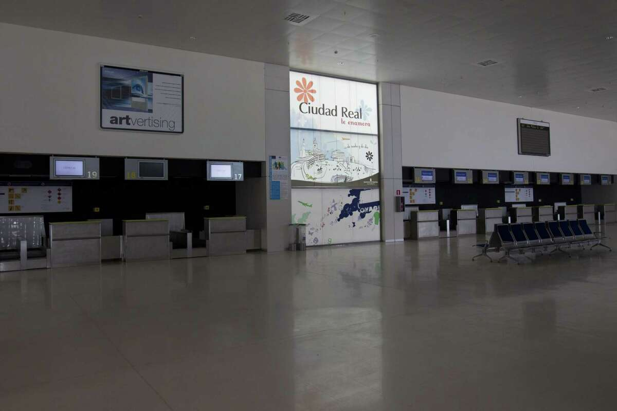 "In this photo taken on May 11, 2011 some check-in desks stand empty at the new Central airport in Ciudad Real, Spain. Ciudad Real's Central airport, one of Spain's ""ghost airports,"" expensive projects that were virtually unused and which became a symbol of the country's wasteful spending during a construction boom received just one bid in a bankruptcy auction on Friday July 17, 2015. after costing some 1.1 billion euros ($1.2 billion) to build. The buyer's offer: 10,000 euros. Spanish news agency Europa Press said Chinese group Tzaneen International tabled the bid in Friday's auction. The receiver had set a minimum price of 28 million euros. If no better bid is received by September, the sale will go through."