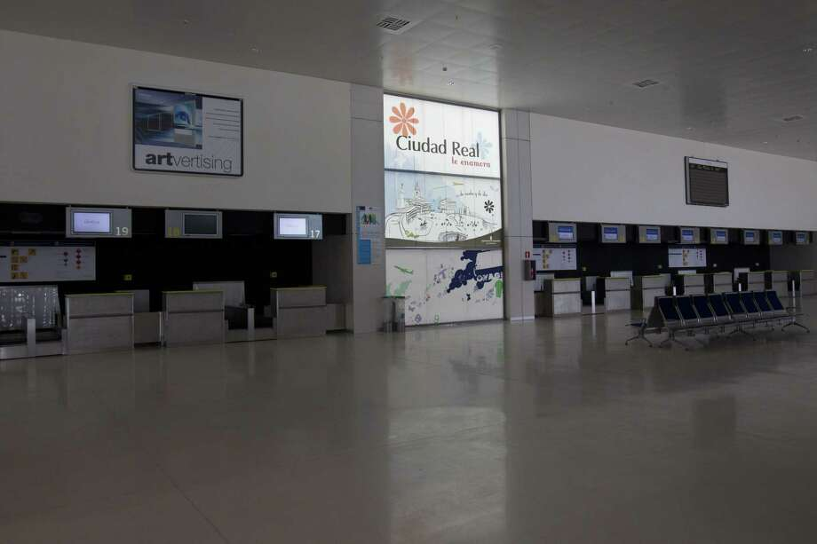"""In this photo taken on May 11, 2011 some check-in desks stand empty at the new Central airport in Ciudad Real, Spain. Ciudad Real's Central airport, one of Spain's """"ghost airports,"""" expensive projects that were virtually unused and which became a symbol of the country's wasteful spending during a construction boom received just one bid in a bankruptcy auction on Friday July 17, 2015. after costing some 1.1 billion euros ($1.2 billion) to build. The buyer's offer: 10,000 euros. Spanish news agency Europa Press said Chinese group Tzaneen International tabled the bid in Friday's auction. The receiver had set a minimum price of 28 million euros. If no better bid is received by September, the sale will go through. Photo: (AP Photo/Paul White) / AP"""