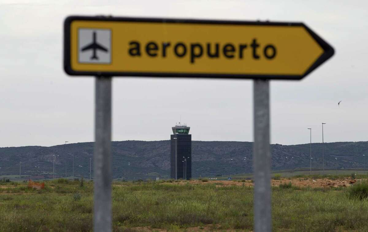 "FILE - In this May 11, 2011 file photo, the new Central airport control tower is framed behind an airport sign in Ciudad Real, Spain. Ciudad Real's Central airport, one of Spain's ""ghost airports,"" expensive projects that were virtually unused and which became a symbol of the country's wasteful spending during a construction boom received just one bid in a bankruptcy auction on Friday July 17, 2015. after costing some 1.1 billion euros ($1.2 billion) to build. The buyer's offer: 10,000 euros. Spanish news agency Europa Press said Chinese group Tzaneen International tabled the bid in Friday's auction. The receiver had set a minimum price of 28 million euros. If no better bid is received by September, the sale will go through."