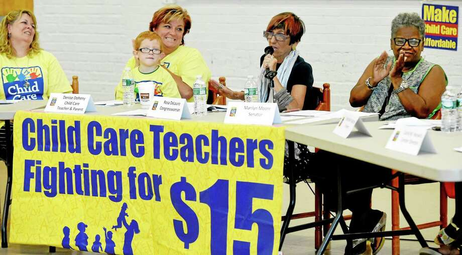 Denise Doheney, left, and Edith Reichard, with her son Keegan, 5, second from left, listen to U.S. Rep. Rosa L. DeLauro, center, and state Sen. Marilyn Moore, right, during a roundtable discussion with child-care workers, administrators and parents Tuesday morning. Photo: Peter Hvizdak — New Haven Register    / ?2015 Peter Hvizdak