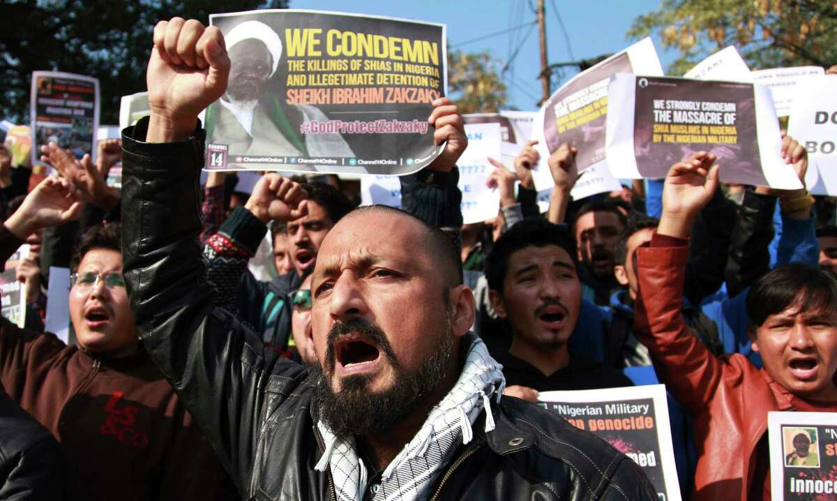 Muslims students carry placards and shout slogans against the Nigerian government against the killings of hundreds of Shiite Muslims and detaining their leader Ibraheem Zakzaky in Nigeria, in Jammu, India, Tuesday, Dec. 15, 2015. Nigerian Soldiers killed hundreds of Shiite Muslims this weekend after their group opened fire on the convoy of Nigeria's army chief, the Shia Islamic Movement and military reports said Monday.