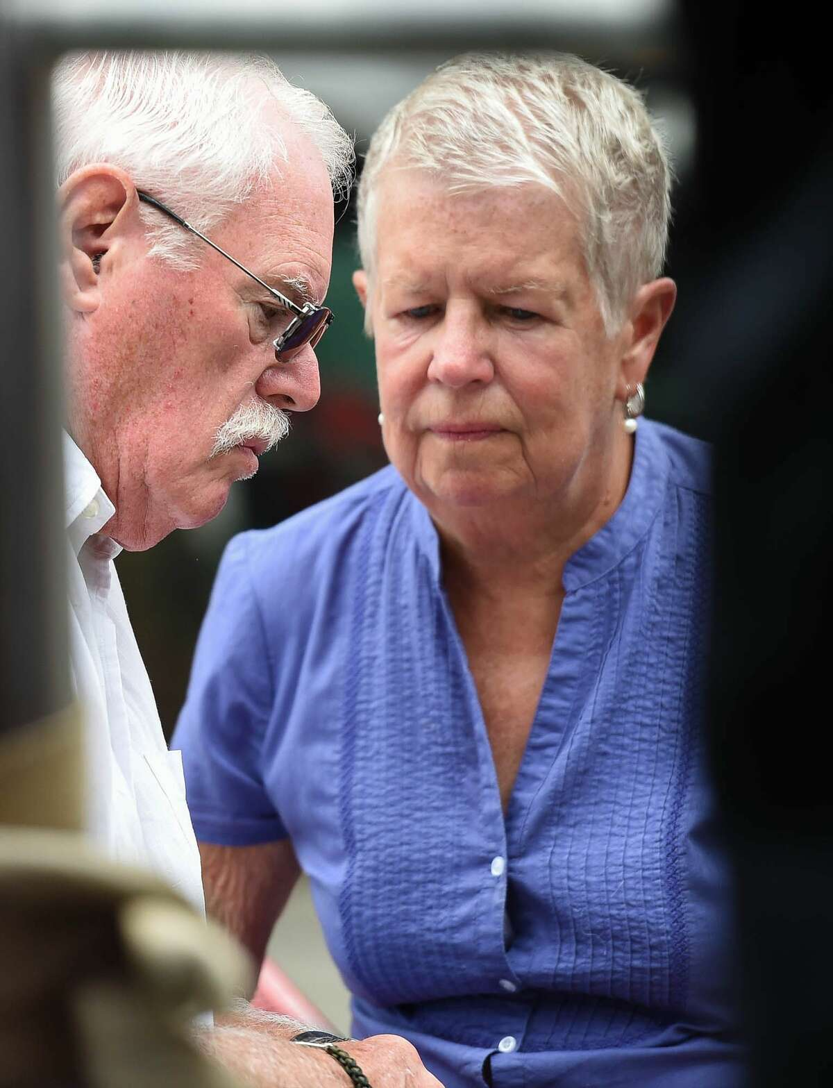 John and Mary Lyon, parents of missing sisters Katherine and Shelia, listen during a news conference on developments in the investigation of the disappearance of 10-year-old Katherine Lyon and 12-year-old Shelia Lyon in 1975. in Wheaton, Md., Wednesday, July 15, 2015.