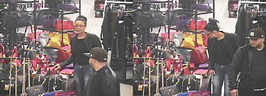 Police are looking to identify these two individuals who they say purchased over $1,200 worth of merchandise with stolen credit card information. Photo: Clinton Police Department