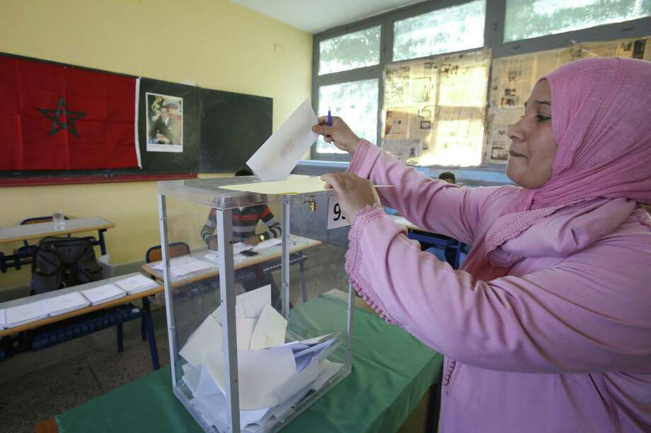 A Moroccan woman casts her ballot in a polling station for the municipal elections in Casablanca, Morocco, on Sept. 4. Photo: AP Photo   / AP