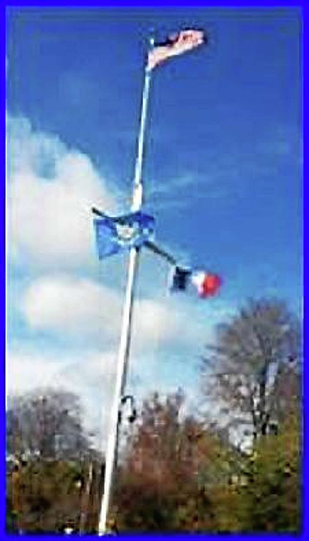 The French flag flies on the flagpole beside the state flag outside the governor's official residence.
