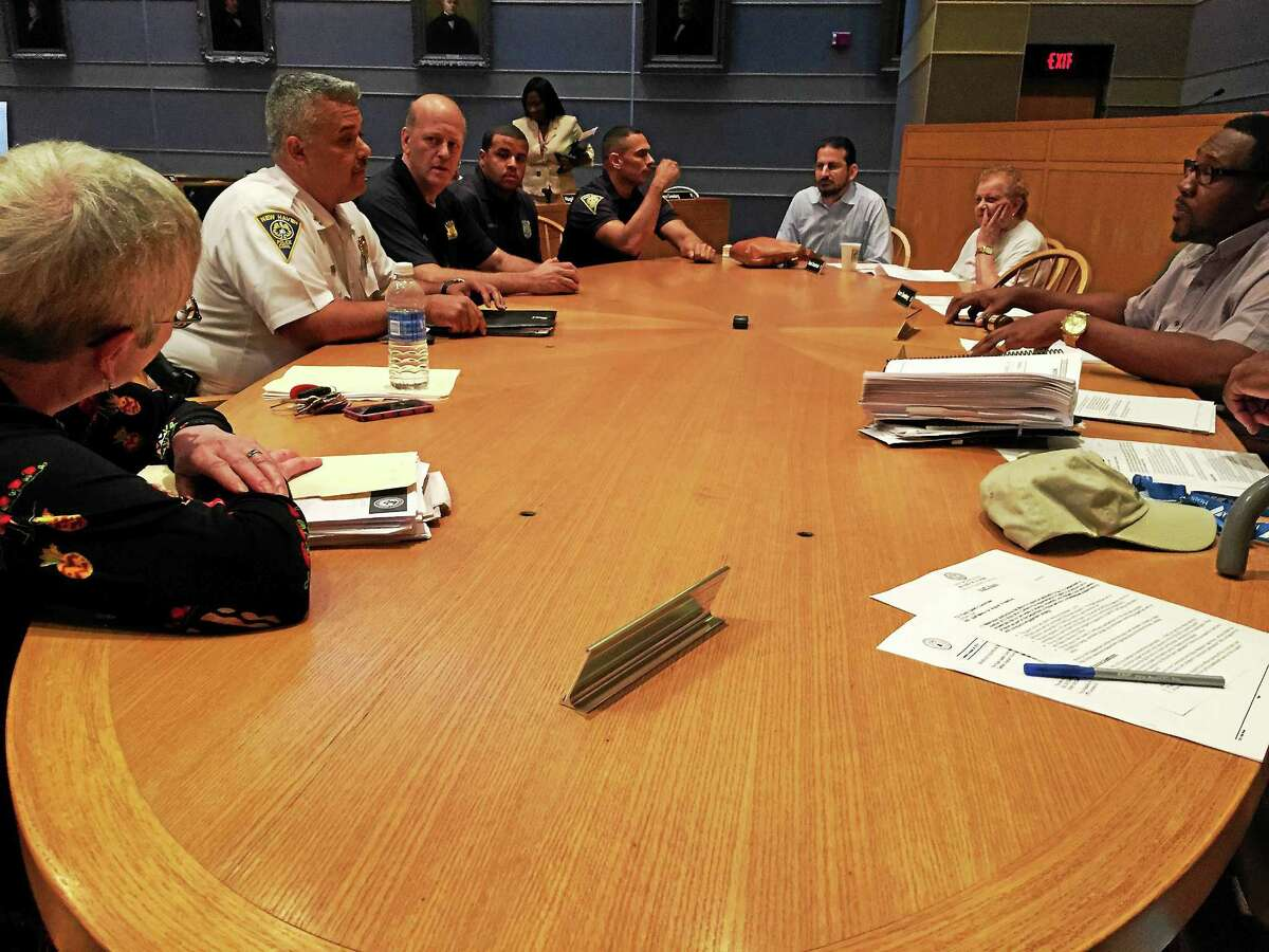 New Haven Police Department leaders, including police Chief Dean Esserman, meet with the Board of Alders' Public Safety Committee to discuss a body camera initiative Tuesday.