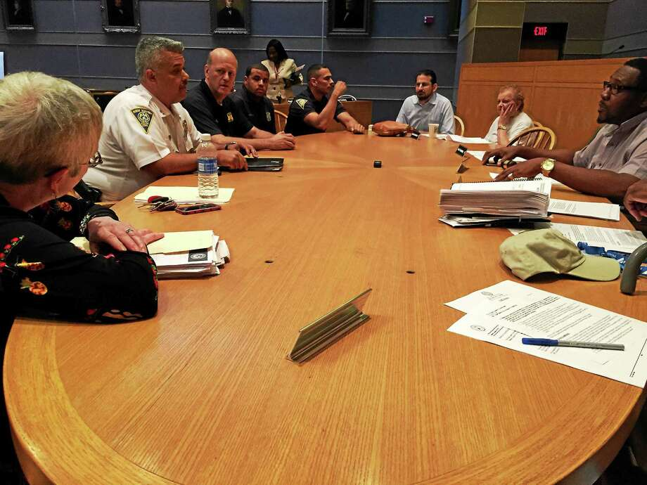 New Haven Police Department leaders, including police Chief Dean Esserman, meet with the Board of Alders' Public Safety Committee to discuss a body camera initiative Tuesday. Photo: Esteban L. Hernandez — New Haven Register