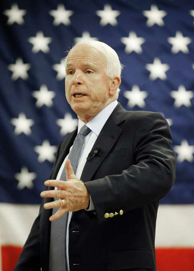 Sen. John McCain, R-Ariz., speaks on a variety of topics with employees at Robertson Fuel Systems Tuesday, June 30, 2015, in Tempe, Ariz. The defense contractor designs and builds equipment to protect ground vehicles and combat aircraft. Photo: (AP File Photo/Ross D. Franklin) / AP