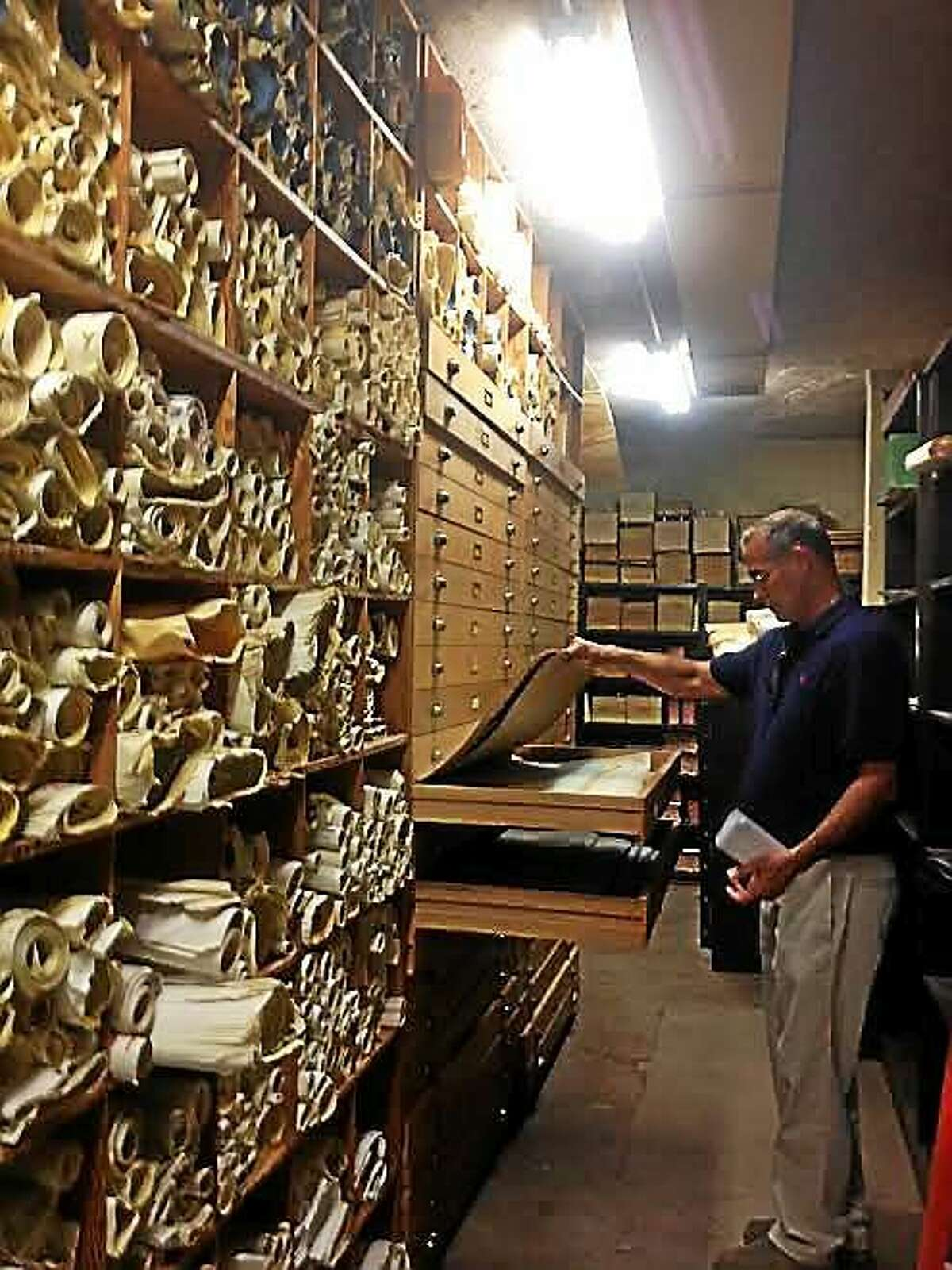 The city's vault with oldest building drawings and maps inspected by Building Official Jim Turcio.