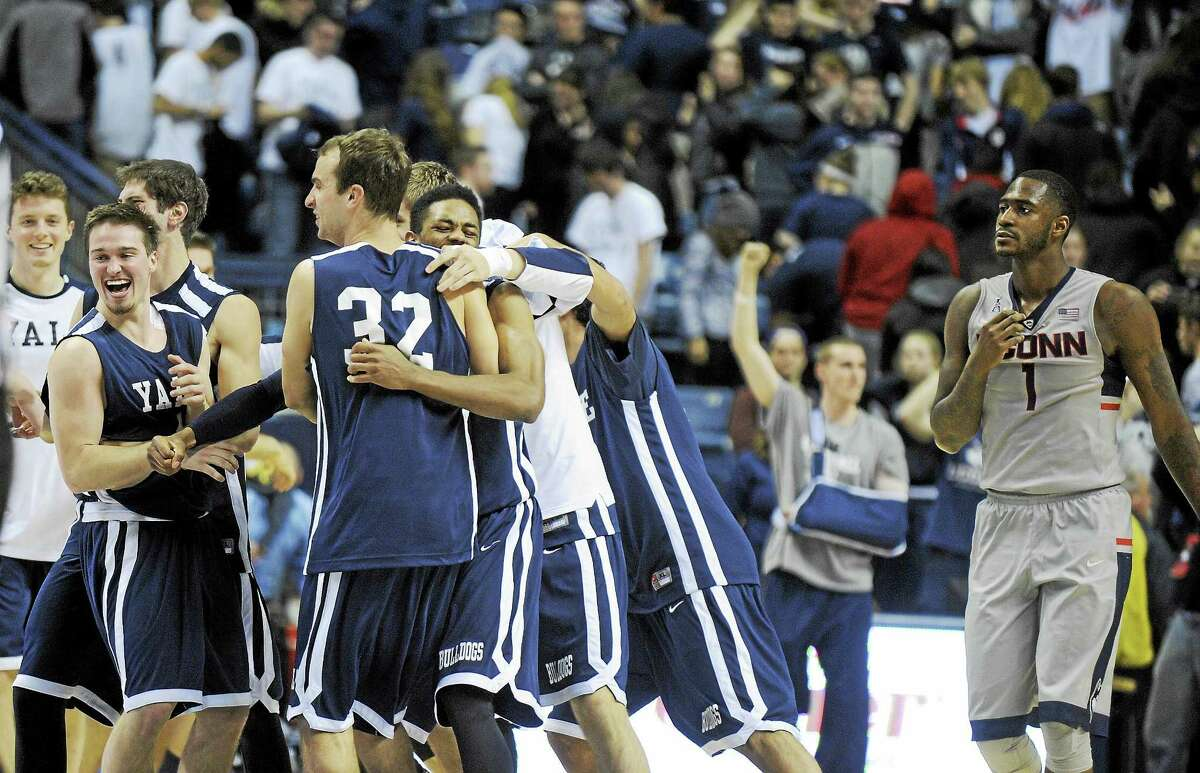 Members of Yale men's basketball team celebrate their win over UConn last December.