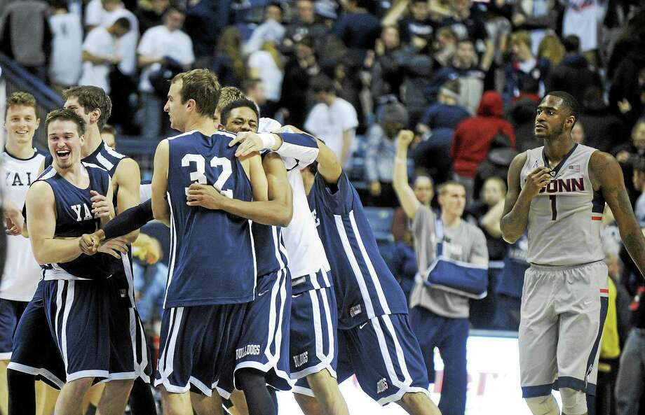 Members of Yale men's basketball team celebrate their win over UConn last December. Photo: The Associated Press File Photo   / FR153656 AP