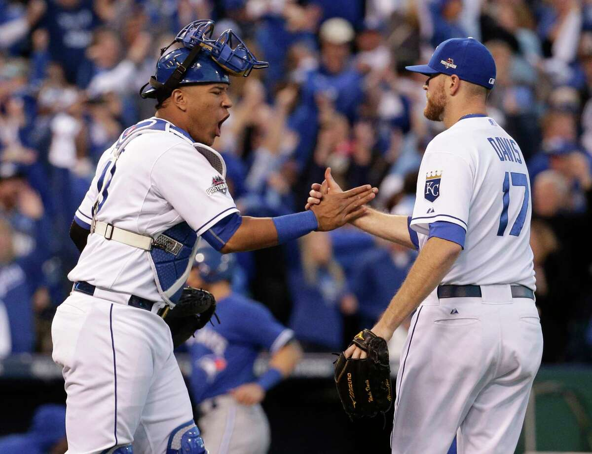 Royals catcher Salvador Perez, left, and relief pitcher Wade Davis celebrate their 6-3 win over the Blue Jays on Saturday.