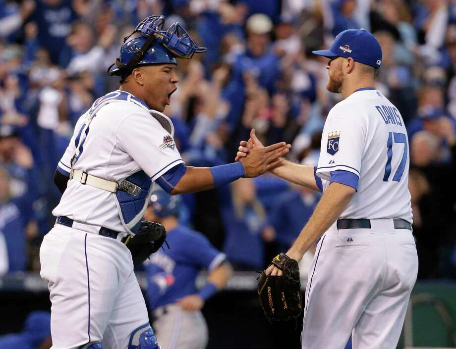 Royals catcher Salvador Perez, left, and relief pitcher Wade Davis celebrate their 6-3 win over the Blue Jays on Saturday. Photo: Charlie Riedel — The Associated Press   / AP