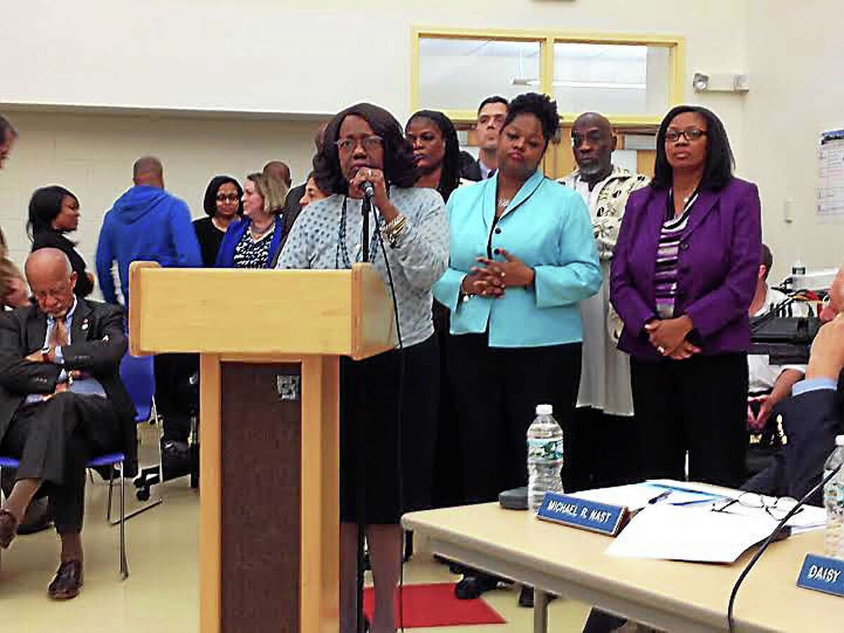 Cheryl Brown, president of the New Haven School Administrators Association, speaks with SAA members standing behind her on Dec. 14.
