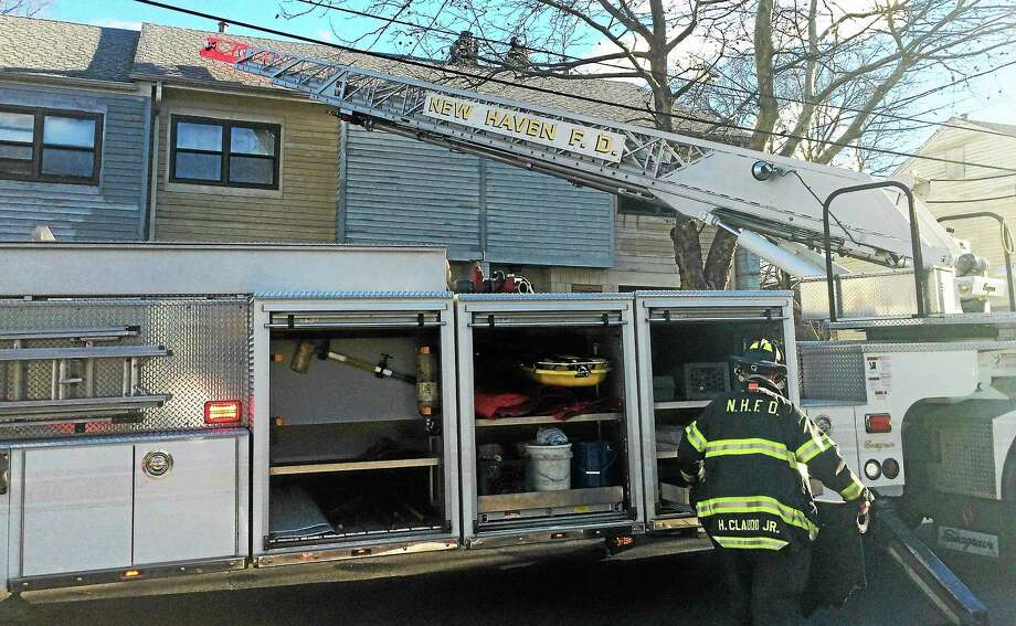 Five people were forced from their home after a fire broke out at 31 Bond St. Tuesday morning. Photo: (Wes Duplantier -- New Haven Register)