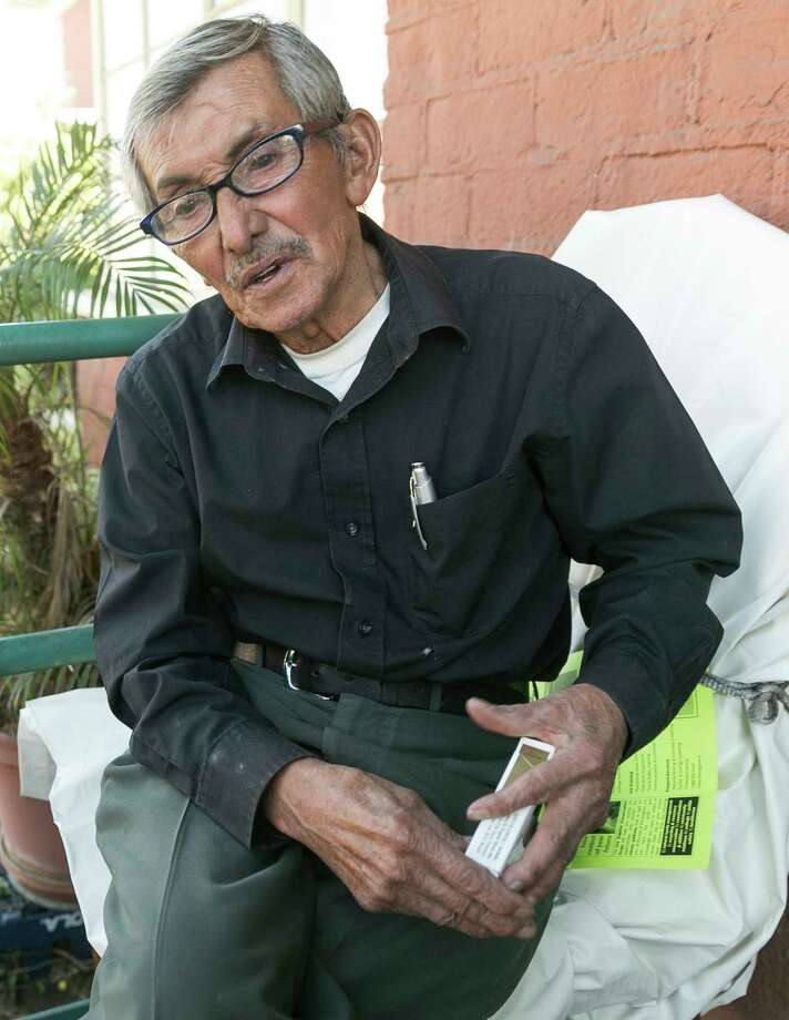 "Resident Juan Manuel Cabrera, 77, who has been smoking for 67 years, says no federal edict is going to stop him from lighting up in his own house at the William Mead Homes in Los Angeles, Thursday, Nov. 12, 2015. ""When I'm in my house I don't bother nobody and nobody bothers me,"" Cabrera said as he relaxed on his porch with his chubby brown Chihuahua, Dunko, an ashtray within arm's reach and a pack of Marlboro Lights in his pocket. The federal government's proposal Thursday to ban smoking inside and out of public housing nationwide got a decidedly mixed reaction from the people most affected. Photo: AP Photo/Damian Dovarganes / AP"