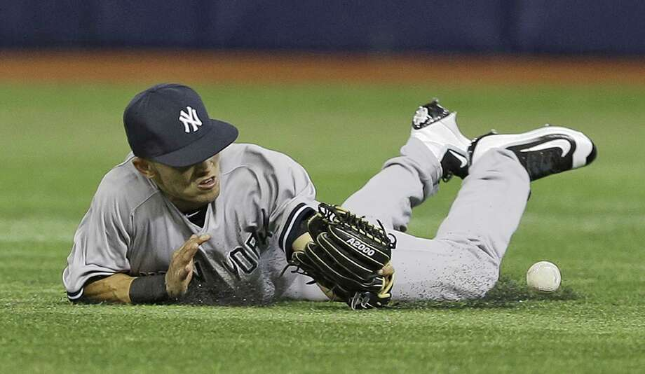New York Yankees right fielder Rico Noel dives but can't hang on to a two-run single by Tampa Bay Rays' J.P. Arencibia during the eighth inning of a baseball game Tuesday, Sept. 15, 2015, in St. Petersburg, Fla.  (AP Photo/Chris O'Meara) Photo: AP / AP